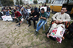 Wounded Palestinians take part in a protest against cutting their salaries by Palestinian president Mahmoud Abbas, in Gaza city on March 13, 2019. Photo by Mahmoud Ajjour