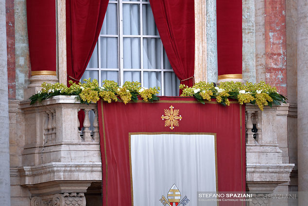 Floral decorations on the central balcony of the Basilica of San Pietro in the Vatican.Pope Francis During the Easter Mass  in St. Peter's Square, at the Vatican.  1 April 2018