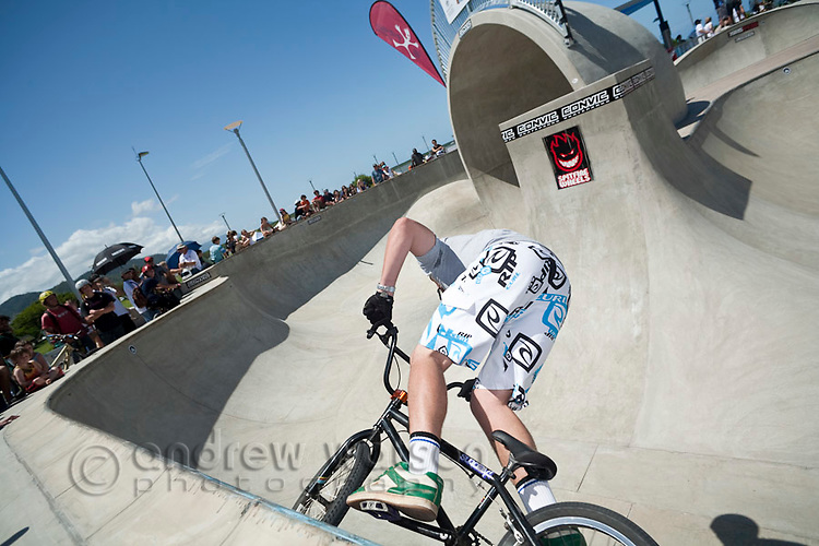 Youth riding BMX bike at skate park.  Cairns, Queensland, Australia