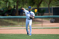 AZL Dodgers third baseman Leonel Valera (23) throws to first base during an Arizona League game against the AZL Padres 2 at Camelback Ranch on July 4, 2018 in Glendale, Arizona. The AZL Dodgers defeated the AZL Padres 2 9-8. (Zachary Lucy/Four Seam Images)