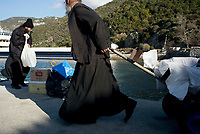 Mount Athos - The Holy Mountain.<br /> Monks take deliveries to and from monasteries from the main port of Mount Athos called Dafne.<br /> <br /> Photographer: Rick Findler