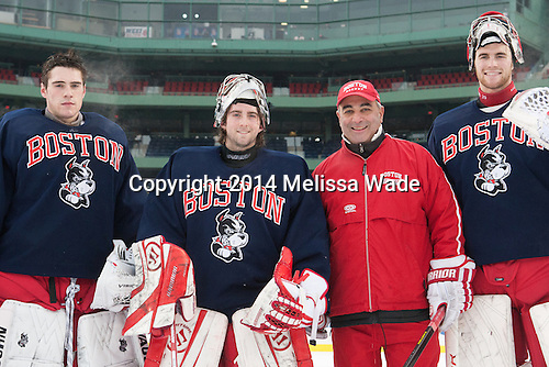 Sean Maguire (BU - 31), Anthony Moccia (BU - 1), Mike Geragosian (BU - Assistant Coach), Matt O'Connor (BU - 29) - The participating teams in Hockey East's second doubleheader during Frozen Fenway practiced on January 10, 2014 at Fenway Park in Boston, Massachusetts.