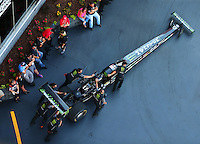 Jun 17, 2016; Bristol, TN, USA; Crew members push the car of NHRA top fuel driver Brittany Force during qualifying for the Thunder Valley Nationals at Bristol Dragway. Mandatory Credit: Mark J. Rebilas-USA TODAY Sports