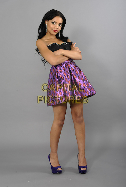 Kira Martin.The Shameless star on a fashion shoot, London, England..October 4th, 2012.**Exclusive. Double fees apply**  studio.full length black strapless top purple skirt arms crossed red print.CAP/FIN.©Steve Finn/Capital Pictures.