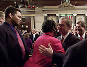 """United States President George W. Bush greets U.S. Representative Sheila Jackson Lee (Democrat of Texas), as as U.S. Representative Jesse Jackson Jr. (Democrat of Illinois), left, and U.S. Senate Majority Leader Trent Lott (Republican of Mississippi), right look on after Bush  addressed a Joint Session of the 107th Congress, Tuesday, February 27, 2001 at the Capitol in Washington, D.C.  Bush outlined his tax cut proposal and other budget issues for the year. The President sought to rally the nation Tuesday behind massive tax cuts, promising to lead Washington along """"a different path"""" with increased spending on popular programs, less government debt and a $1 trillion reserve fund.<br /> Credit: Doug Mills / Pool via CNP"""