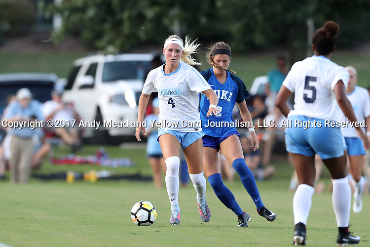 CARY, NC - AUGUST 18: North Carolina's Bridgette Andrzejewski (4) and Duke's Chelsea Burns (2). The University of North Carolina Tar Heels hosted the Duke University Blue Devils on August 18, 2017, at Koka Booth Stadium in Cary, NC in a Division I college soccer game.