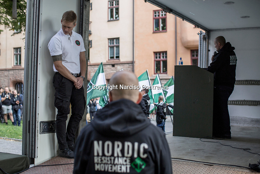 August 25, 2018: A member of the neo Nazi Nordic Resistance Movement NRM (Nordiska motståndsrörelsen) gives a speech to supporters during a demostration at the Kungsholmstorg square in Stockholm, Sweden. An estimate of 200 supporters of the neo-Nazi organisation held a six-hour rally guarded by a strong police deployment.