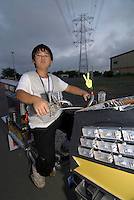 "Shota Hashimoto (13) with his decochari customized bicycle. ""My bike weighs 30 to 40 kilos, so its a bit hard to drive on the road."""