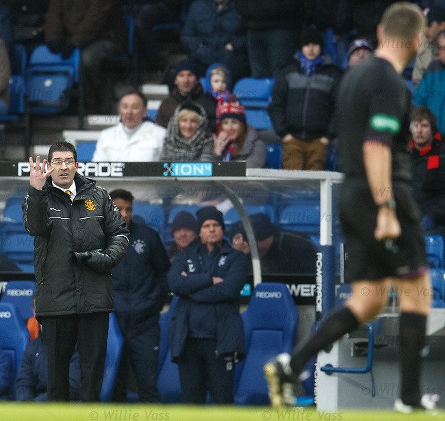 Jim Chapman gestures to the ref that he has played an extra four minutes