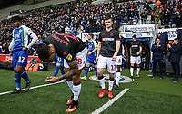 Bolton Wanderers' Josh Magennis and Callum Connolly enter the pitch<br /> <br /> Photographer Andrew Kearns/CameraSport<br /> <br /> The EFL Sky Bet Championship - Wigan Athletic v Bolton Wanderers - Saturday 16th March 2019 - DW Stadium - Wigan<br /> <br /> World Copyright &copy; 2019 CameraSport. All rights reserved. 43 Linden Ave. Countesthorpe. Leicester. England. LE8 5PG - Tel: +44 (0) 116 277 4147 - admin@camerasport.com - www.camerasport.com