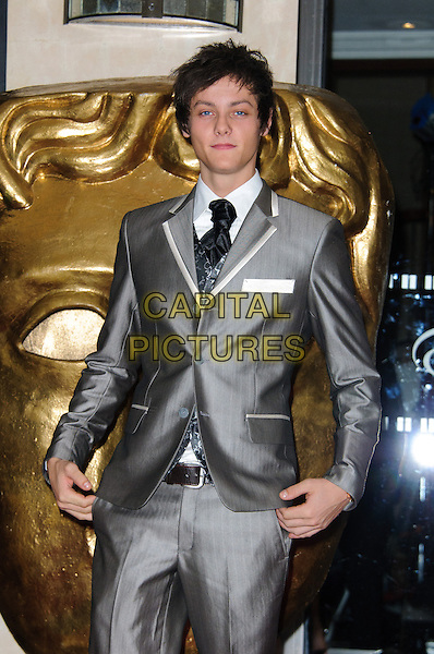 Tyger Drew- Honey.Arrivals at the British Academy Children's Awards at The Hilton, Park Lane, London, England..November 25th, 2012.BAFTA half length grey gray suit.CAP/CJ.©Chris Joseph/Capital Pictures.