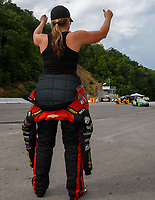 Jun 18, 2017; Bristol, TN, USA; Erica Enders-Stevens celebrates a win by teammate NHRA pro stock driver Alex Laughlin during the Thunder Valley Nationals at Bristol Dragway. Mandatory Credit: Mark J. Rebilas-USA TODAY Sports