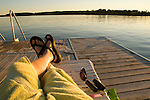 Relaxing on a dock in the summer along a lake
