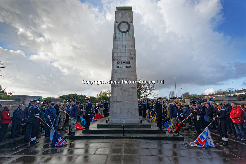 Pictured: Flags are down during the service. Sunday 11 November 2018<br /> Re: Commemoration for the 100 years since the end of the First World War on Remembrance Day at the Swansea Cenotaph in south Wales, UK.