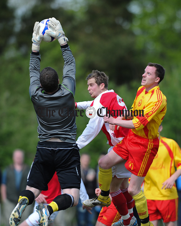 Daithi O Connell of Newmarket in action against John Healy and David Herlihy of Avenue United during their game at Lees road. Photograph by John Kelly.