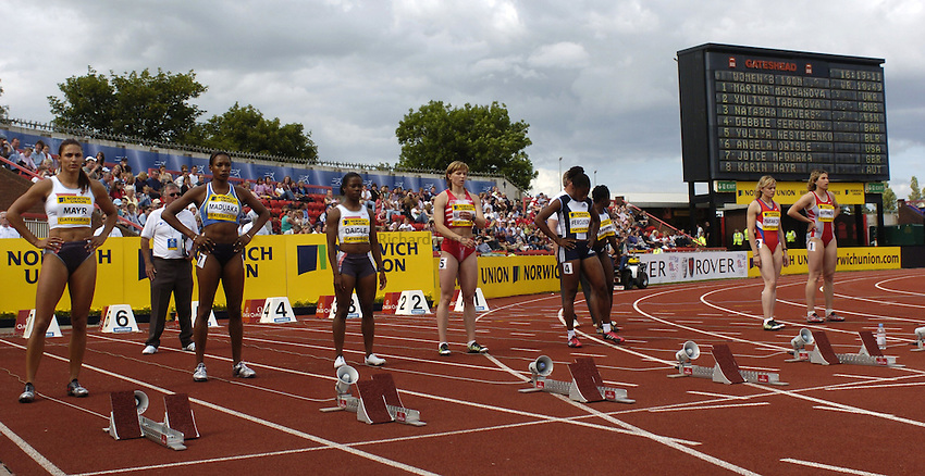 Photo. Jed Wee..Norwich Union British Grand Prix, 27/06/2004..Women's 100m athletes at the start line.
