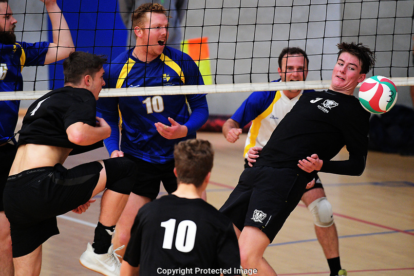 Action from the Volleyball NZ 50th National Club Championship men's division one match between the Harbour Raiders and Hamilton at ASB Sports Centre in Wellington, New Zealand on Saturday, 12 October 2017. Photo: Dave Lintott / lintottphoto.co.nz