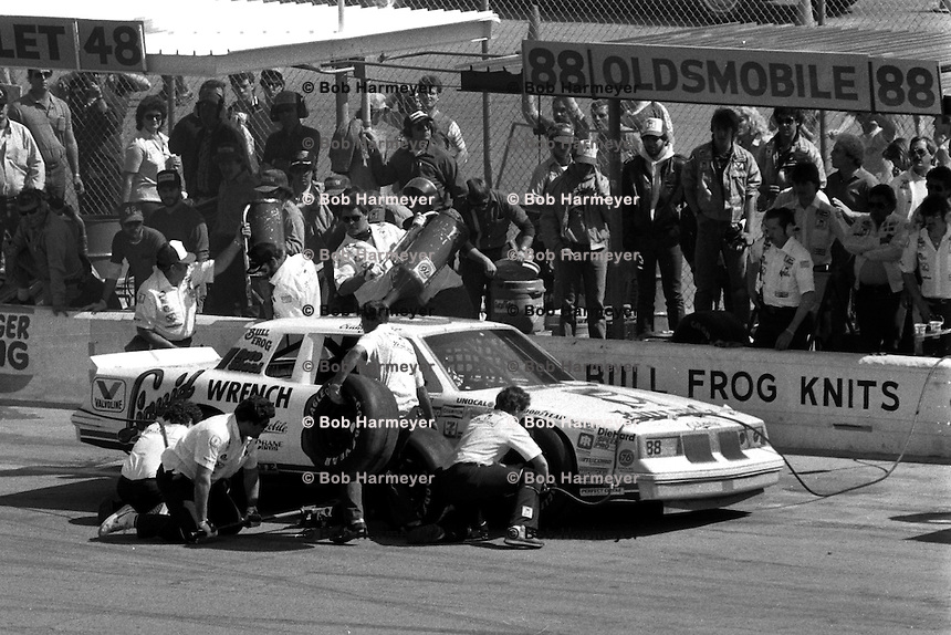 DAYTONA BEACH, FL - FEBRUARY 16: Buddy Baker makes a pit stop in his Oldsmobile during the Daytona 500 NASCAR Winston Cup race at the Daytona International Speedway in Daytona Beach, Florida, on February 16, 1986.