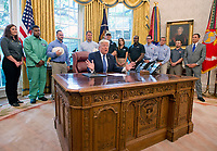 United States President Donald J. Trump makes remarks prior to signing the National Manufacturing Day Proclamation in the Oval Office of the White House in Washington, DC on Friday, October 6, 2017.<br /> CAP/MPI/CNP/RS<br /> &copy;RS/CNP/MPI/Capital Pictures