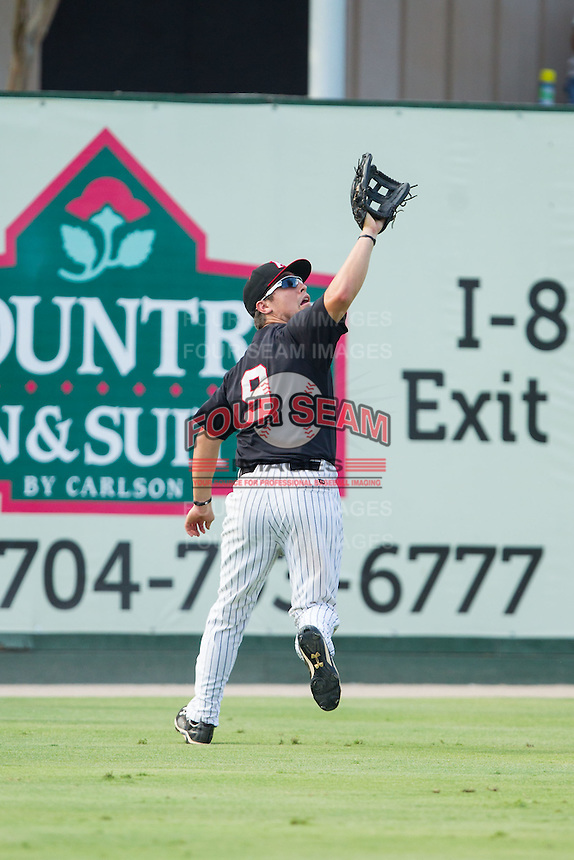 Kannapolis Intimidators left fielder Nolan Early (9) tracks down a fly ball during the game against the Asheville Tourists at CMC-NorthEast Stadium on July 13, 2014 in Kannapolis, North Carolina.  The Tourists defeated the Intimidators 8-2.  (Brian Westerholt/Four Seam Images)