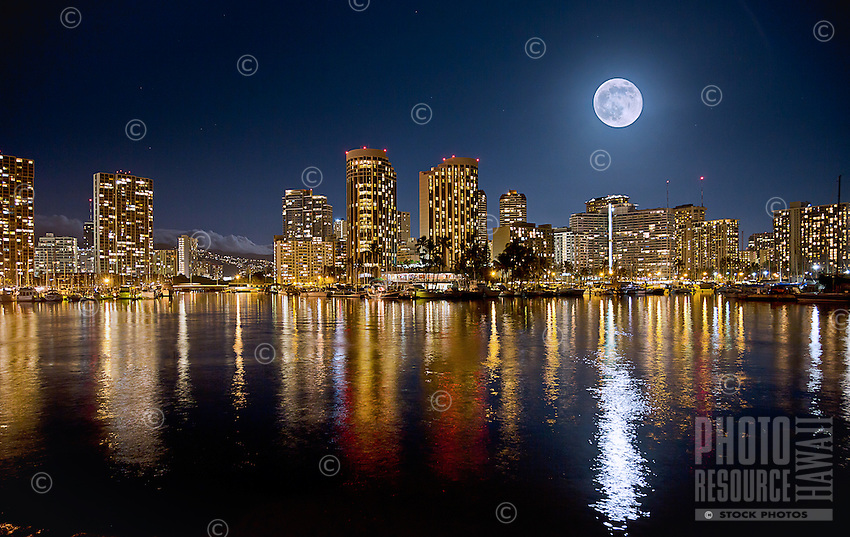 A supermoon rises over Waikiki, Honolulu, O'ahu.