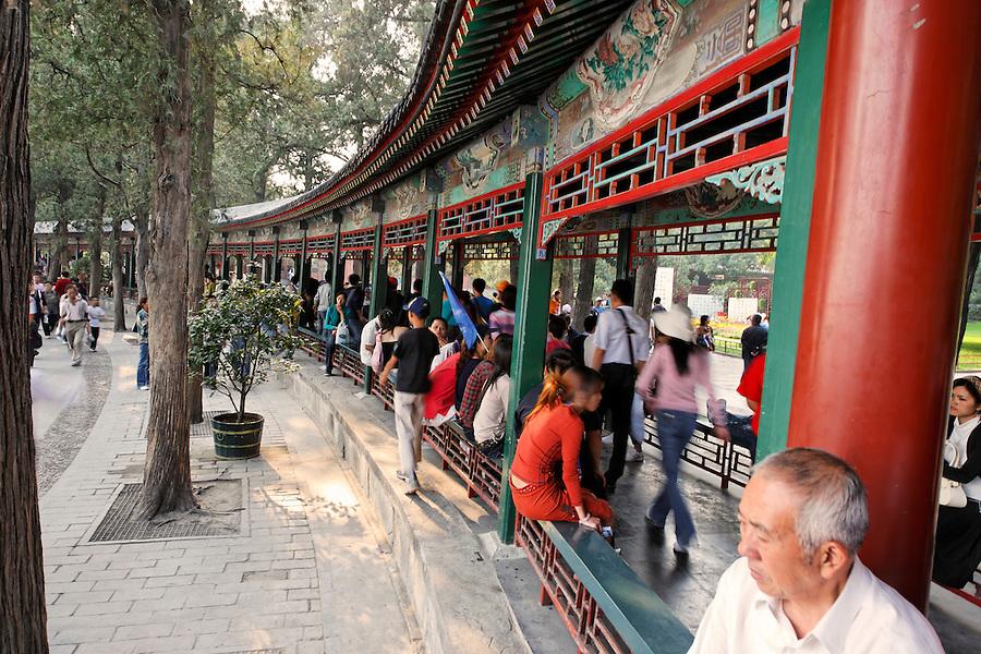 Summer Palace visitors sitting and walking along The Long Corridor, Beijing, China, Asia