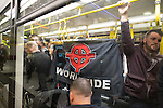 "© Joel Goodman - 07973 332324 . 28/03/2015 . Manchester , UK . Neo-Nazis on a Metrolink tram alongside commuters at Piccadilly in Manchester . Approximately 100 neo-Nazis gather in Manchester for "" White Pride Worldwide day "" . Photo credit : Joel Goodman"