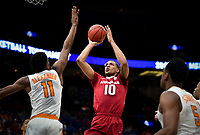 NWA Democrat-Gazette/CHARLIE KAIJO Arkansas Razorbacks forward Daniel Gafford (10) shoots during the Southeastern Conference Men's Basketball Tournament semifinals, Saturday, March 10, 2018 at Scottrade Center in St. Louis, Mo. The Tennessee Volunteers knocked off the Arkansas Razorbacks 84-66