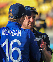NZ captain Brendon McCullum consoles England captain Eoin Morgan after the ICC Cricket World Cup one day pool match between the New Zealand Black Caps and England at Wellington Regional Stadium, Wellington, New Zealand on Friday, 20 February 2015. Photo: Dave Lintott / lintottphoto.co.nz