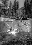 Family member take time to have fun in the Lyell Fork of the Merced River.<br /> <br /> In August of 1987, the family and friends of Ansel Adams made a trip to Mount Ansel Adams to honor Ansel by putting his ashes on the mountain.  Leading the trip were Dr. Michael Adams and his wife, Jeanne, their son, Matthew, and daughter, Sarah.  Also in the group were Ansel&rsquo;s daughter, Anne Adams Helms, and her husband, Ken Helms, and Anne's daughters, Virginia (Ginny) Mayhew and Sylvia Mayhew Desin, and Sylvia&rsquo;s husband, Greg Desin.  Other members of the trip were Roger and Mitzi Hall, Matt Weston, Mrs. Desin (Greg&rsquo;s mother), and Billy Butler.  The Adams family invited me along with Leo Stutzin (Modesto Bee reporter) and my eldest son, Aaron Golub.  <br /> <br /> With some of us on horseback and others on foot, we began the hike at Tuolumne High Sierra Camp and headed to Vogelsang High Sierra Camp for the first night out.  The second day, we began by climbing through Vogelsang Pass, then descended by switchback down to Lewis Creek.  After climbing up from the creek we hiked by the Cony Crags before descending into the Lyell Fork of the Merced River ending up near Hutchings Creek at what is now referred to as the Ansel Adams Camp.  <br /> <br /> This camp was originally known generically as a Sierra Club Camp, but has more recently been referred to as Ansel Adams Camp because in 1934, Ansel led a Sierra Club outing to the Lyell Fork of the Merced River.  After the group climbed the then-unnamed peak that Adams called &ldquo;The Tower in Lyell Fork,&quot; they gathered around the campfire and agreed that the peak should bear Ansel&rsquo;s name.  The U.S. Geological Survey does not, however, permit naming features for living individuals, so the peak did not officially become Mt. Ansel Adams until 1985, one year and one day after his death.  Photo by Al Golub/Golub Photography