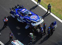 Apr. 28, 2012; Baytown, TX, USA: Aerial view of NHRA crew members for funny car driver Robert Hight during qualifying for the Spring Nationals at Royal Purple Raceway. Mandatory Credit: Mark J. Rebilas-