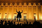 Florent Gallaire, a protestor, stands on top of the fences in front of the National Assembly during a spontaneous protest against the CPE (new labor contract for the youth)on March 31, 2006.