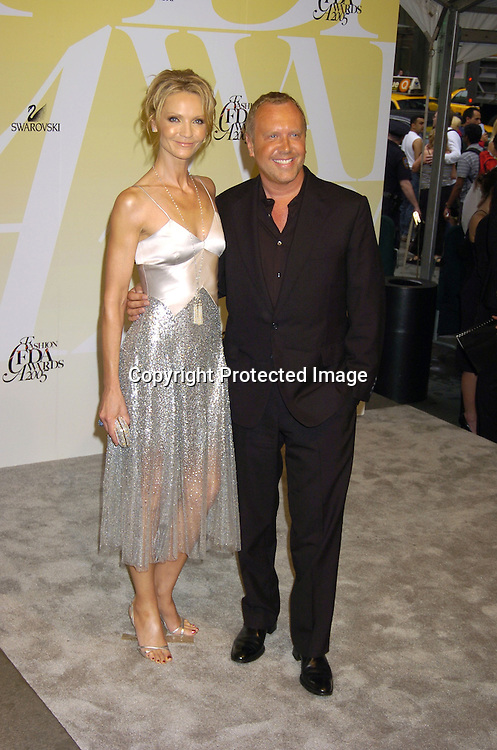 Joan Allen and Michael Kors..at the 2005 CFDA Fashion Awards on June 6, 2005 at ..the New York Public Library. ..Photo by Robin Platzer, Twin Images