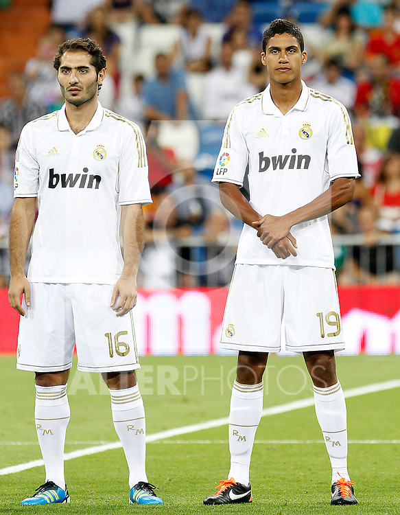 Real Madrid's Raphael Varane (r) and Hamit Altintop during Santiago Bernabeu Trophy.August 24,2011. (ALTERPHOTOS/Acero)