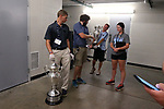 KANSAS CITY, KS - SEPTEMBER 20: Club staff carry the trophies from Sporting Kansas City's 2004, 2012, and 2015 USOC championships from storage to the press box. Sporting Kansas City hosted the New York Red Bulls on September 20, 2017 at Children's Mercy Park in Kansas City, KS in the 2017 Lamar Hunt U.S. Open Cup Final. Sporting Kansas City won the match 2-1.