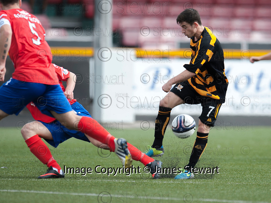 Alloa's Kevin Cawley's shot is blocked.