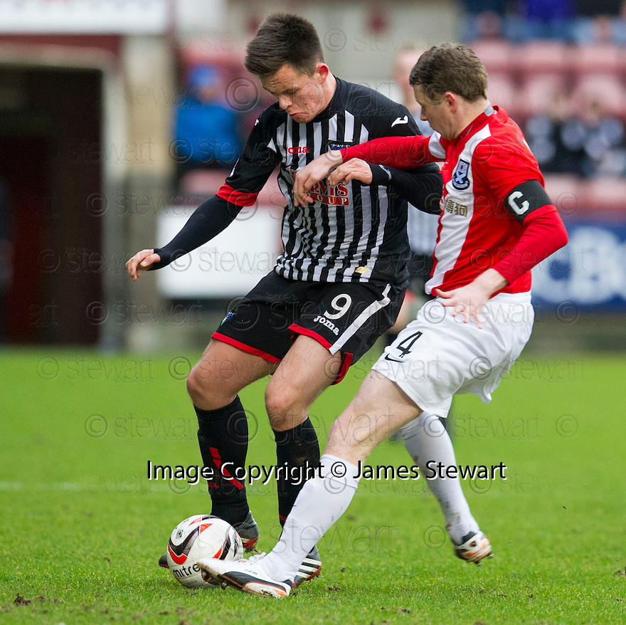 Pars' Lawrence Shankland and Ayr Utd's Scott McLaughlin challenge for the ball.