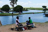 ZAMBIA Barotseland Mongu, Mulamba harbour at river Zambezi flood plain / SAMBIA Barotseland , Stadt Mongu , Hafen Mulamba in der Flutebene des Zambezi Fluss