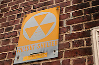 A fallout shelter sign is pictured on a Brooklyn Heights building in the New York City borough of Brooklyn, NY, Monday August 1, 2011. A fallout shelter is an enclosed space specially designed to protect occupants from radioactive debris or fallout resulting from a nuclear explosion.