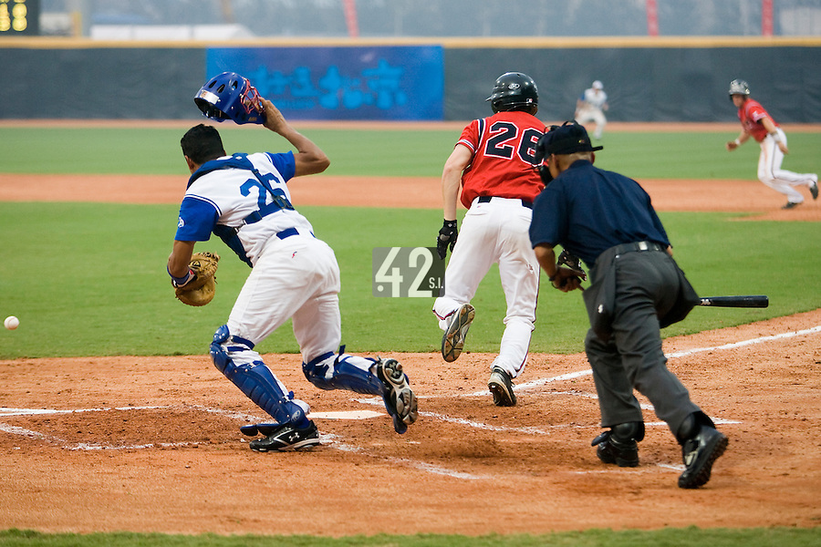 20 August 2007: #28 Jan Homolka bunts as #26 Jamel Boutagra goes for the ball during the Czech Republic 6-1 victory over France in the Good Luck Beijing International baseball tournament (olympic test event) at the Wukesong Baseball Field in Beijing, China.