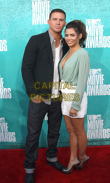Channing Tatum & Jenna Dewan.2012 MTV Movie Awards held at the Gibson Amphitheatre, Universal City, California, USA..3rd June 2012.full length jacket jeans denim black white grey gray white skirt green blouse top plunging neckline cleavage married husband wife clutch bag.CAP/ADM/SLP/LS.©Lee Sherman/Starlitepics/AdMedia/CapitalPictures.