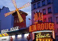 Paris, Ile de France, France, Europe, Moulin Rouge in the Pigalle Area of Paris in the evening.