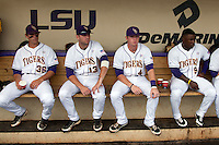 LSU Tigers players (L to R) Austin Nola #36, Alex Edward #13, Raph Rhymes #4, and Arby Fields #9 sit in the dugout before the continuation of their suspended NCAA Super Regional baseball game against Stony Brook on June 9, 2012 at Alex Box Stadium in Baton Rouge, Louisiana. LSU defeated Stony Brook 5-4 in 12 innings. (Andrew Woolley/Four Seam Images)