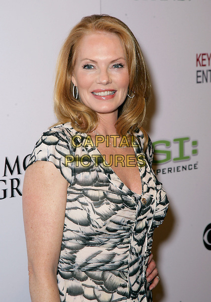 "MARG HELGENBERGER.The Cast and crew of CSI celebrate the opening of ""CSI: The Experience"" inside the MGM Grand Resort Hotel and Casino, Las Vegas, Nevada, USA..September 12th, 2009.half length white black cream beige pattern dress .CAP/ADM/MJT.© MJT/AdMedia/Capital Pictures."