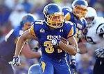 BROOKINGS, SD - AUGUST 31:  Zach Zenner #31 from South Dakota State University looks for an opening against Butler in the first quarter Saturday evening at Coughlin Alumni Stadium in Brookings. (Photo by Dave Eggen/Inertia)