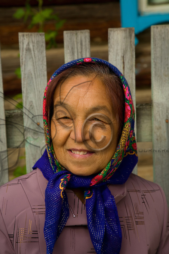 Portrait of a babushka who shows in her features the oriental origins of her people.