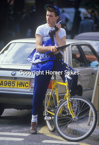 Bike courier with large mobile phone 1980s. London Uk