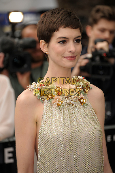 Anne Hathaway (wearing Gucci).'The Dark Knight Rises' European premiere at Odeon Leicester Square cinema, London, England..18th July 2012.half length embellished jewel encrusted flowers floral pearls collar short cropped hair sleeveless silver gold cream beige dress .CAP/PL.©Phil Loftus/Capital Pictures.