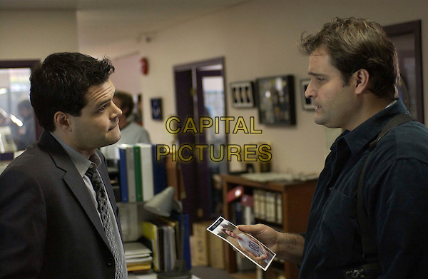 """Detectives Jack Sclafani (Aaron Douglas) and George Brennan (Peter Deluise) weigh the evidence in an unsolved murder investigation in the all new, original Mary Higgins Clark suspense-drama, """"Before I Say Goodbye,"""" a PAX TV Original Movie. .Filmstill - Editorial Use Only.Ref: FB.sales@capitalpictures.com.www.capitalpictures.com.Supplied by Capital Pictures.."""