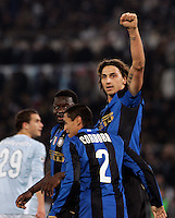 Football, Italian serie A: Lazio vs Inter Milan. Rome, Olympic stadium, 6 december 2008. Inter Milan forward Zlatan Ibrahimovic, of Sweden, right, celebrates with teammates Ivan Cordoba, center, and Sulley Muntari after scoring..Calcio, Serie A: Lazio vs Inter. Roma, stadio Olimpico, 6 dicembre 2008..UPDATE IMAGES PRESS/Riccardo De Luca